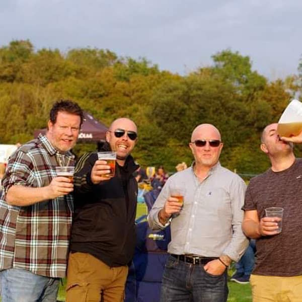 A group of guys enjoying a beer at one of our events