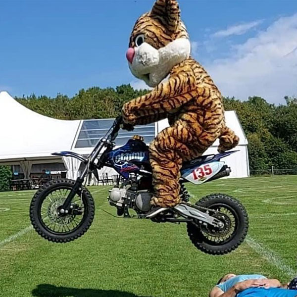 A tiger mascot jumping on a motorcycle