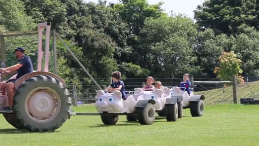 Children being pulled along on the Tractor Ride