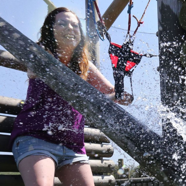 A young girl having fun in the splash zone