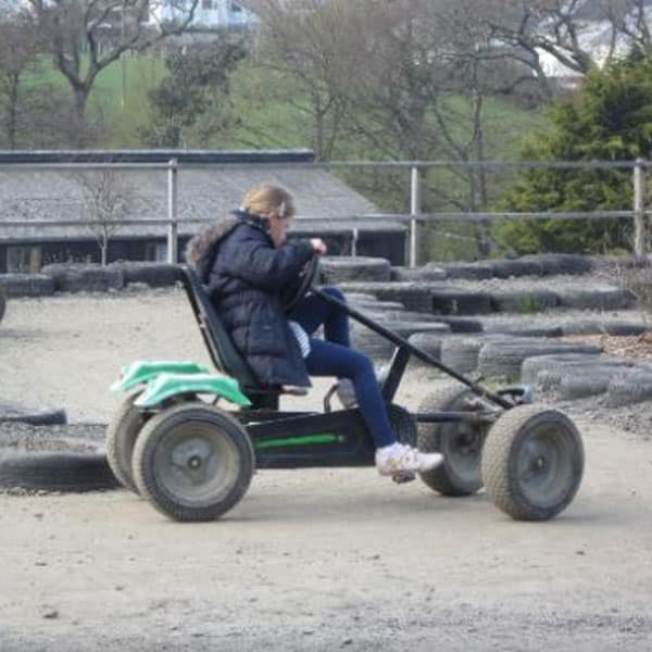 A young girl having fun on the go-kart track
