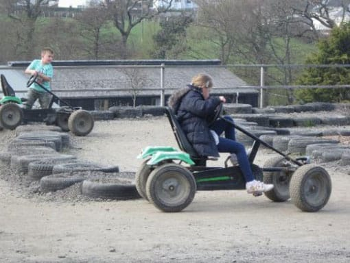 A young girl on the go-kart track