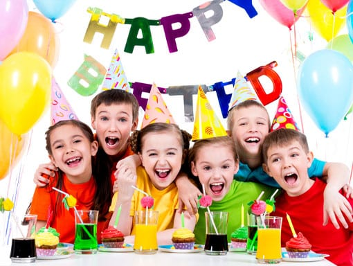 Everyone smiling at a kids birthday party venue