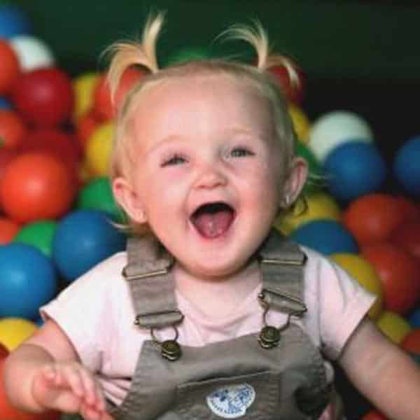 Happy toddler in the ball pit