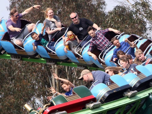 People zooming along on the Rampage Roller Coaster