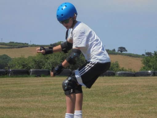 Teenager off-road skateboarding at The Big Sheep Adventure Centre