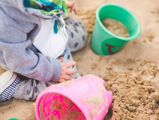 Toddler having fun in our sandpit