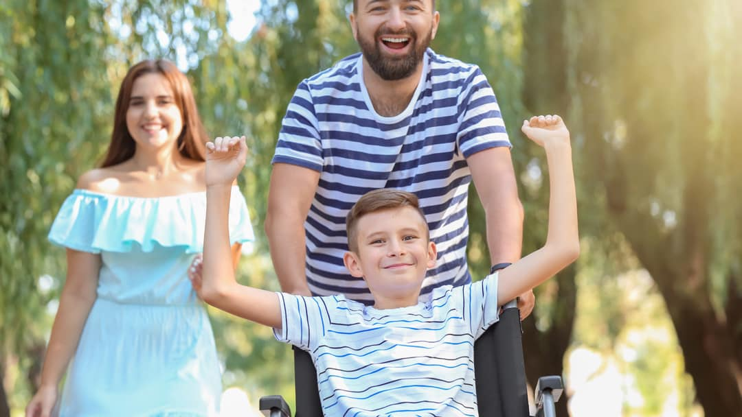 A child in a wheelchair enjoying a day out