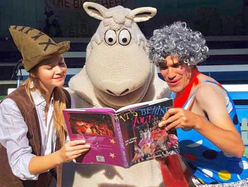 Wooly The Sheep reading a book with a clown
